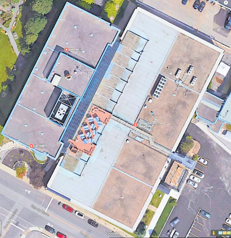Réfection toitures et mur rideau siège social de Gaz Métro, Montréal, QC, Canada.